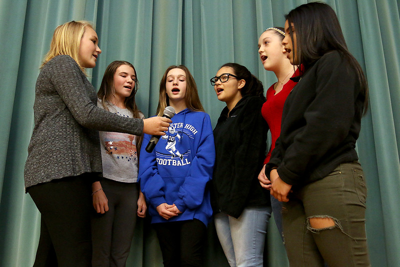 Samoset Middle School in Leominster held lunch with veterans on Thursday, November 9, 2017. Singing the national anthem at the lunch is, from left, eighth graders Riah Dean, Sophie Houle, Emily Harper, Jia Delgado, Lindsey Cavanagh and Paola Sepulveda.  SENTINEL & ENTERPRISE/JOHN LOVE
