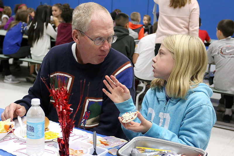 Samoset Middle School in Leominster held lunch with veterans on Thursday, November 9, 2017. Air Force veteran Staff Sgt. Doug Moore chats with his granddaughter sixth grader Riley Moore, 11, during the lunch. SENTINEL & ENTERPRISE/JOHN LOVE