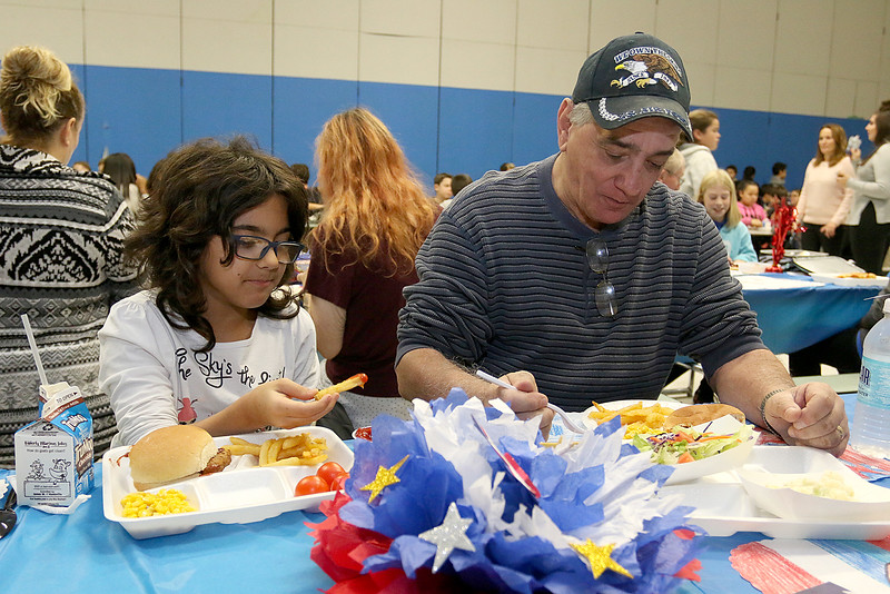 Samoset Middle School in Leominster held lunch with veterans on Thursday, November 9, 2017. Sixth grader Mariana Miola and her Gradfather Air Force veteran Sgt. Lou Miola enjoy the lunch. SENTINEL & ENTERPRISE/JOHN LOVE
