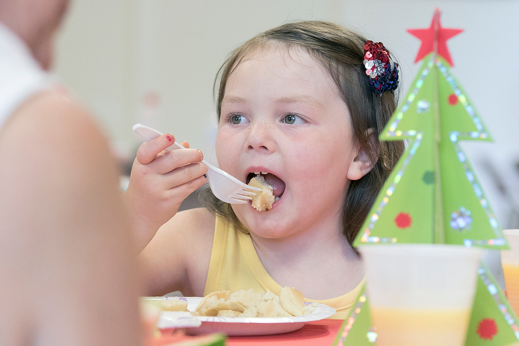. Pancakes, sausage, fruit, juice, milk, and coffee was served at the Lunenburg Boys and Girls Club fundraiser Christmas in July with Santa Claus. Enjoying some pancakes at the fundraiser is Paisley Dupuis, 4. SENTINEL & ENTERPRISE/JOHN LOVE