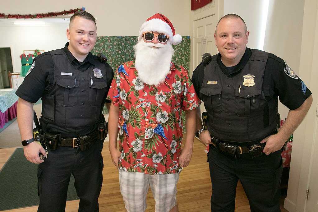 . Pancakes, sausage, fruit, juice, milk, and coffee was served at the Lunenburg Boys and Girls Club fundraiser Christmas in July with Santa Claus. Posing with Santa during their visit to the fundraiser was Patrolman Sam Christensen and Sgt. Sean Zrate. Zrate is also on the Boys and Girls Club board. SENTINEL & ENTERPRISE/JOHN LOVE