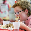 Pancakes, sausage, fruit, juice, milk, and coffee was served at the Lunenburg Boys and Girls Club fundraiser Christmas in July with Santa Claus. Enjoying some pancakes at the fundraiser is Donovan Raferzeder, 13, a member of the club. SENTINEL & ENTERPRISE/JOHN LOVE