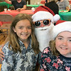 Pancakes, sausage, fruit, juice, milk, and coffee was served at the Lunenburg Boys and Girls Club fundraiser Christmas in July with Santa Claus. Posing with Santa during the fundraiser is Saoirse Halligan, 11, and Shealeigh Halligan, 10, from Lunenburg. SENTINEL & ENTERPRISE/JOHN LOVE