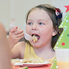 Pancakes, sausage, fruit, juice, milk, and coffee was served at the Lunenburg Boys and Girls Club fundraiser Christmas in July with Santa Claus. Enjoying some pancakes at the fundraiser is Paisley Dupuis, 4. SENTINEL & ENTERPRISE/JOHN LOVE