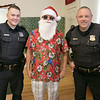 Pancakes, sausage, fruit, juice, milk, and coffee was served at the Lunenburg Boys and Girls Club fundraiser Christmas in July with Santa Claus. Posing with Santa during their visit to the fundraiser was Patrolman Sam Christensen and Sgt. Sean Zrate. Zrate is also on the Boys and Girls Club board. SENTINEL & ENTERPRISE/JOHN LOVE