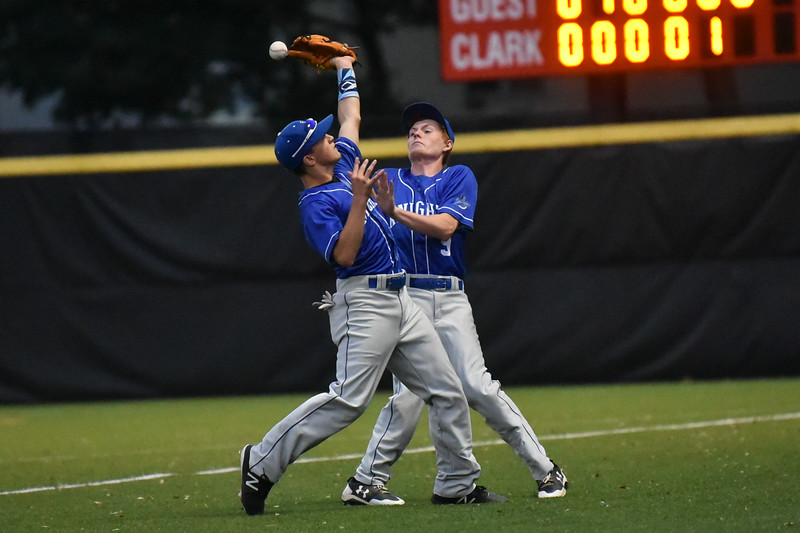 Nick Oulette (front ) of Lunenburg and teammate Jacob Barnes nearly collide after an attempt to catch a foul ball which resulted in the out during Division 4 Central semi-finals against Littleton at Clark University in Worcester.  [Wicked Local photo/Jeff Porter