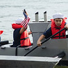 Solen Chappell, 8, Nathan Henry, 8, and Dylan Ervin, 8, paddle during the annual Lunenburg cardboard boat race on Saturday afternoon. SENTINEL & ENTERPRISE / Ashley Green