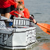 """Theresa Letarte, 5, dressed at """"Rey"""" from Star Wars, paddles during the annual Lunenburg cardboard boat race on Saturday afternoon. SENTINEL & ENTERPRISE / Ashley Green"""