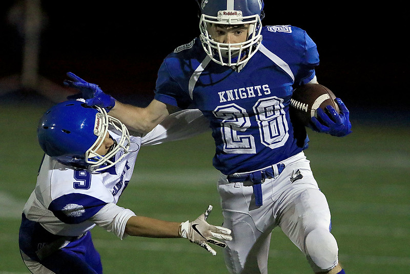 Lunenburg High School football played Narragansett High School on Friday night, September 28, 2018. LHS's Duncan Poitras pushes NHS's Sak Ramos out of the way as he gets some yards during action in the game. SENTINEL & ENTERPRISE/JOHN LOVE