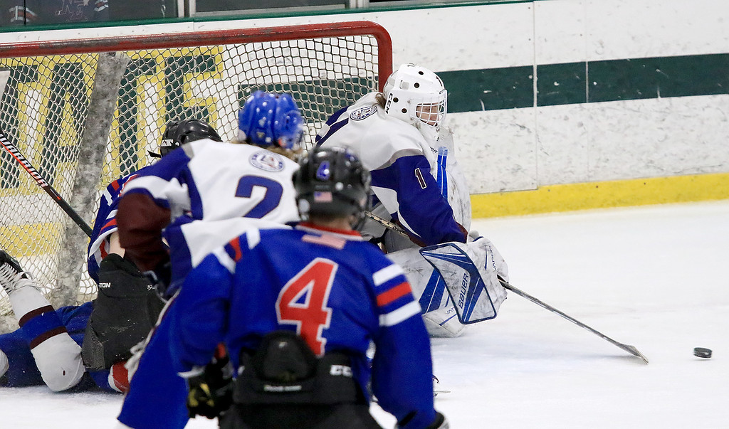 . Hopedale Junior Senior High School played Lunenburg Middle High School/Ayer Shirley Regional High School on Wednesday, February 27, 2019 at Fitchburg State University\'s Wallace Civic Center in Fitchburg. Lunenburg\'s Goalie Anthony Firmani reaches for a loose puck. SENTINEL & ENTERPRISE/JOHN LOVE