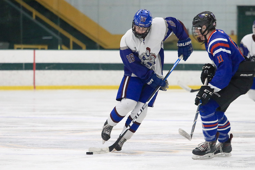 . Hopedale Junior Senior High School played Lunenburg Middle High School/Ayer Shirley Regional High School on Wednesday, February 27, 2019 at Fitchburg State University\'s Wallace Civic Center in Fitchburg. Lunenburg\'s Aaron O\'Connor gets control of the puck. SENTINEL & ENTERPRISE/JOHN LOVE