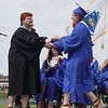 Cassandra DiGeronimo received her diploma from Superintendent Loxi Jo Calmes. (SENTINEL & ENTERPRISE / AMANDA BURKE)