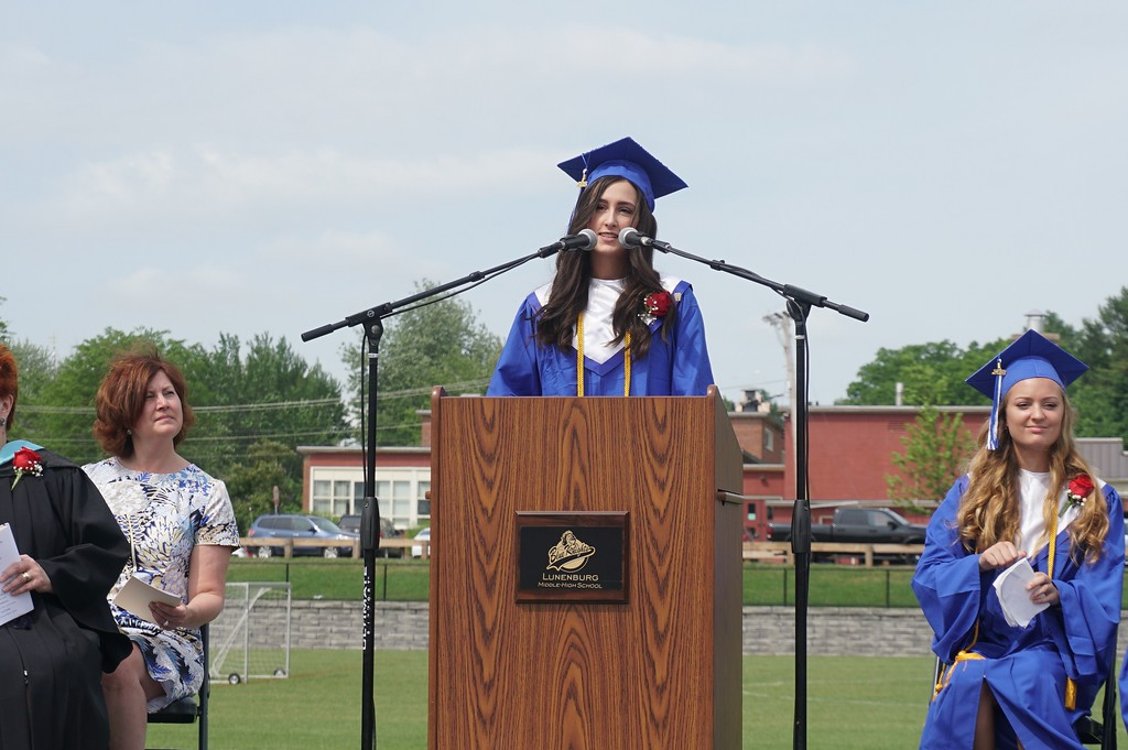 . Class of 2018 salutatorian Sarah Hinsley addresses the crowd at Lunenburg High School\'s Saturday morning commencement ceremony. (SENTINEL & ENTERPRISE / AMANDA BURKE)