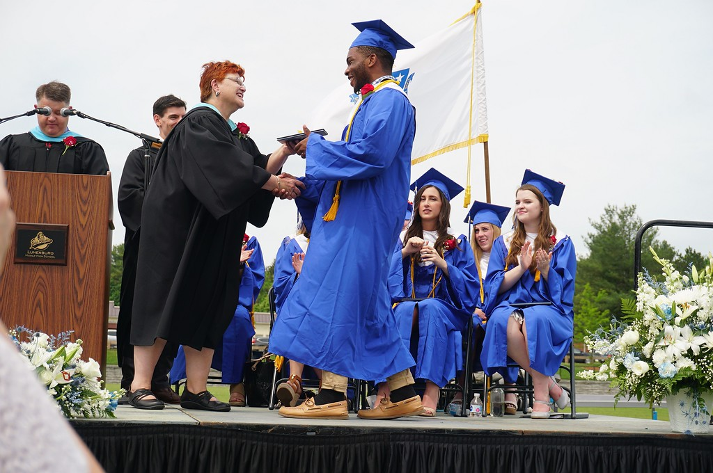 . Mike Alain Tenie-Kengmeni received his diploma from Superintendent Loxi Jo Clames at commencement on Saturday. (SENTINEL & ENTERPRISE / AMANDA BURKE)