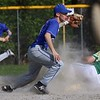 Lunenburg Middle High School baseball player Drew Thibeault  just misses the tag on Clinton High School player Spencer Taylor as he steals third during their game on Friday afternoon in Lunenburg at Marshall Park. SENTINEL & ENTERPRISE/JOHN LOVE