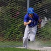 Lunenburg Middle High School baseball player Adam Peplowski  takes off down the first baseline after getting a hit during action in their game against Clinton High School on Friday afternoon in Lunenburg at Marshall Park. SENTINEL & ENTERPRISE/JOHN LOVE