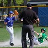 Lunenburg Middle High School baseball player Nick Oullette  and Clinton High School player George Kehn look to the umpire for the call, which was out, during their game on Friday afternoon in Lunenburg at Marshall Park. SENTINEL & ENTERPRISE/JOHN LOVE