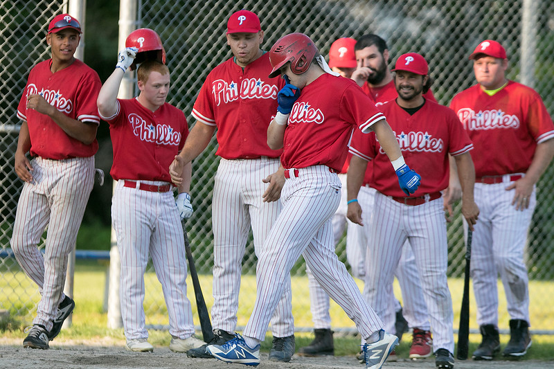 Lunenburg Phillies hosted Auburn in Game 3 of a best-of-three semifinal series at Marshall Park in Lunenburg on Thursday, August 1, 2019. Phillies's Connor Wironen makes his to home plate as he teammates wait to congratulate him on his homerun. SENTINEL & ENTERPRISE/JOHN LOVE