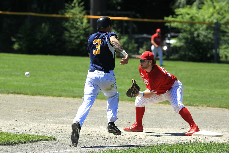 Brennan Cuddahy cut's down Shewsbury player at 1st base SENTINEL&ENTERPRISE/Scott LaPrade