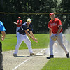 After the out at 3rd base by Jon Belliard, Shewsbury coach argues the play at the umpire<br /> SENTINEL&ENTERPRISE/Scott LaPrade