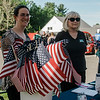 Michelle Haggstrom, of Keller Williams, and Susar Roser, of Exit Realty Partners, hand out flags during the Lunenburg Police Relief Association's first ever Cruise Night held on Wednesday, June 14, 2017. SENTINEL & ENTERPRISE / Ashley Green