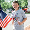 Jake Zivojinovic, 8, waves a flag during the Lunenburg Police Relief Association's first ever Cruise Night held on Wednesday, June 14, 2017. SENTINEL & ENTERPRISE / Ashley Green