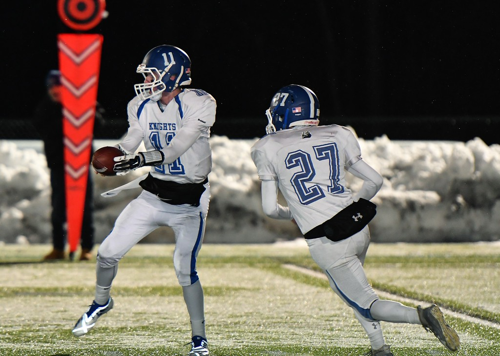 . Lunenburg QB, Christopher Costich hands off to Dawson Powell. Sentinel & Enterprise / Jim Fay