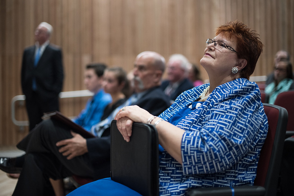 . Lunenburg superintendent Loxi Jo Calmes looks up at the president of the class of 2017 during Saturday\'s ribbon cutting ceremony at Lunenburgs new high school.  Sentinel & Enterprise photo/Jeff Porter