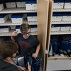Members of the Lunenburg High School band grab outfits from a closet in the new building on Saturday which is said to make what was a hectic process a much smoother one. Sentinel & Enterprise photo/Jeff Porter