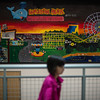 A young girl walks past a mural which migrated from the old building into the foyer of the new building during Saturdays open house at the new High School in Lunenburg.  Sentinel & Enterprise photo/Jeff Porter