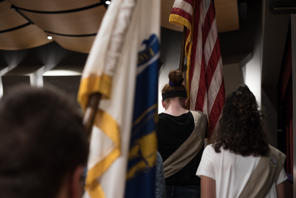 . Girls scouts walk the American flag onto the stage for the playing of our National Anthem during Saturdays ribbon cutting ceremony at the Lunenburg High School\'s new building.  Sentinel & Enterprise photo/Jeff Porter