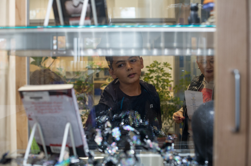 . Waleed Quasim, 10, of Lunenburg looks through the library window during Lunenburg\'s High/Middle School open house on Saturday.  Sentinel & Enterprise photo/Jeff Porter
