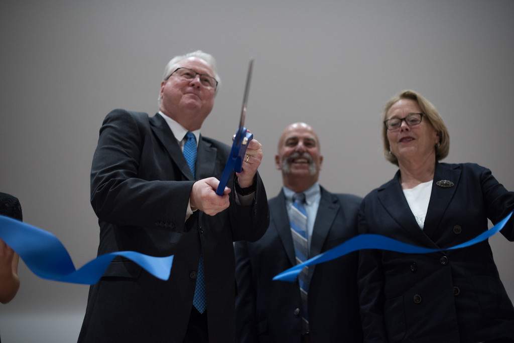 . Michael Mackin (left),  Jamie Toale (center)  and Niki Tsongas (right)  cut the ribbon to officially open Lunenburg High School on Saturday inside the new building.  Sentinel & Enterprise photo/Jeff Porter