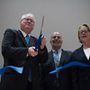 Michael Mackin (left),  Jamie Toale (center)  and Niki Tsongas (right)  cut the ribbon to officially open Lunenburg High School on Saturday inside the new building.  Sentinel & Enterprise photo/Jeff Porter