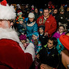 Santa greets children on the Lunenburg Town Common during the annual tree lighting ceremony on Thursday evening. SENTINEL & ENTERPRISE / Ashley Green