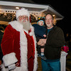 Dylan Kelly, 1, and grandfather Tom Lawlor greet Santa on the Lunenburg Town Common during the annual tree lighting ceremony on Thursday evening. SENTINEL & ENTERPRISE / Ashley Green