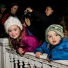 Leah, 5, and Tyler Newton, 2, wait for Santa on the Lunenburg Town Common during the annual tree lighting ceremony on Thursday evening. SENTINEL & ENTERPRISE / Ashley Green