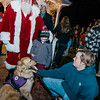 Hunter Specht, service dog Angel and mom Sarah greet Santa during the annual tree lighting ceremony on Thursday evening. SENTINEL & ENTERPRISE / Ashley Green