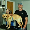 Veterinarian Tech. Assistant, Emily Moyen with 6 Month old , Gus and Gus's owner, Paul Benoit from Lancaster.