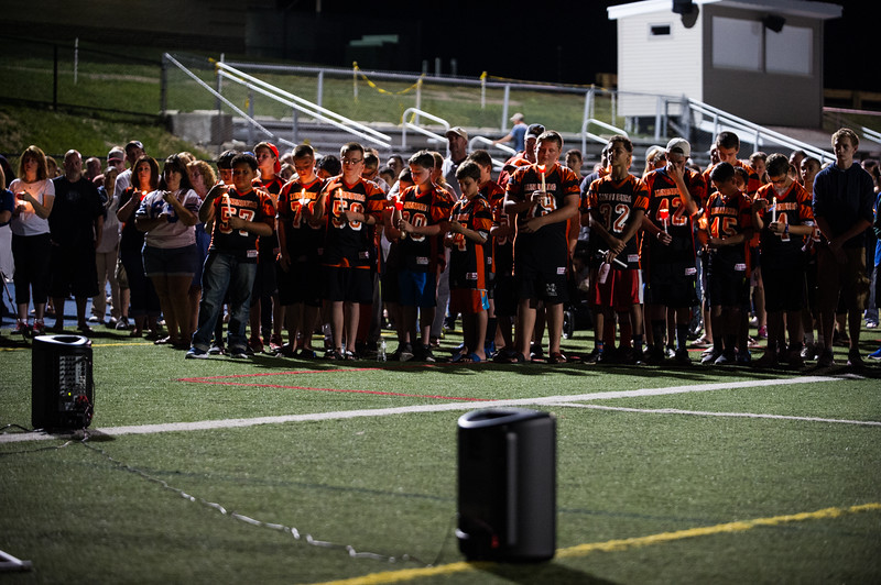 Lunenberg AYF football team gather on the Lunenburg High School football field to commemorate 18 year old class of 2016 graduate, A.J. Robbins, who died early Saturday morning in a car accident.  Sentinel & Enterprise photo/Jeff Porter