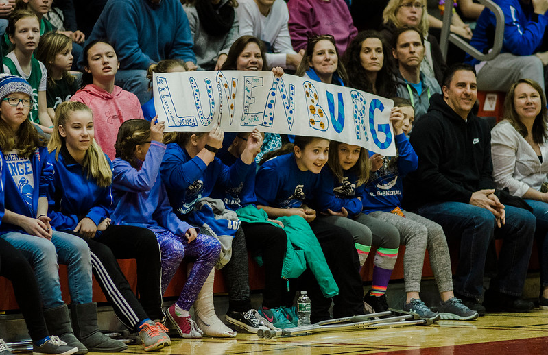 Lunenburg fans hold a sign during the Division 3 Central Mass. final against Grafton at Worcester Polytechnic Institute on Saturday, March 11, 2017. Lunenburg would defeat Grafton 55-54 in overtime. SENTINEL & ENTERPRISE / Ashley Green