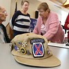 Lunenburg resident and WWII veteran Clarence Goguen turned 100 years old last October and on Saturday at the Eagle House in Lunenburg he was given the Boston Post Cane as the oldest living person in town. His 10th Mountain division hat sits on the table as many come up to congratulate him after the ceremony.SENTINEL & ENTERPRISE/JOHN LOVE