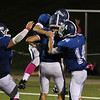 Players jump on Kyle Crowley after scoring a TD