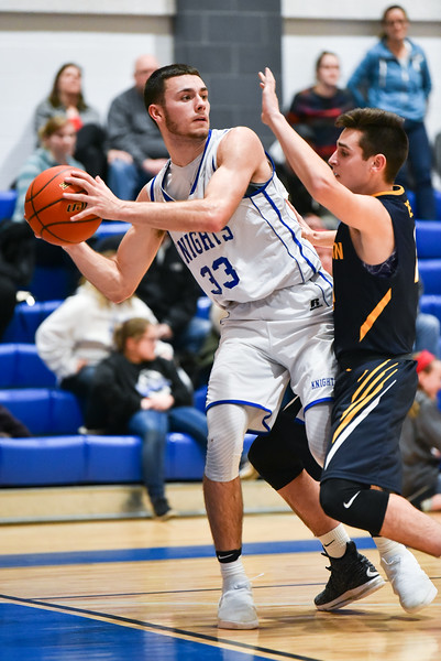 (01/30/18 LUNENBURG MA) Lunenburg senior captain Connor Palma (left) passes the ball to the top of the key with pressure from Littleton defender in Tuesday night's game at Lunenburg High School.  SENTINEL & ENTERPRISE JEFF PORTER