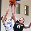 (01/30/18 LUNENBURG MA) Blue Knights senior William Cochran (10) attempts a lay up with a block from Littleton senior captain Mitch Crory on Tuesday at Lunenburg High School.  SENTINEL & ENTERPRISE JEFF PORTER