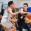 (01/30/18 LUNENBURG MA) Knights senior captain Nicolas Gonzalez (left) moves in front of a pass by Littleton sophomore Tony DesSisto in Tuesday night's boys varsity basketball game at Lunenburg High School.  SENTINEL & ENTERPRISE JEFF PORTER