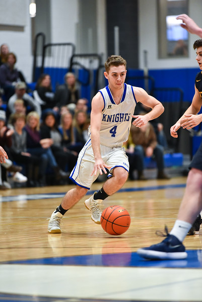 (01/30/18 LUNENBURG MA) Lunenburg senior Drew Thibeault dribbles around Littleton defender on Tuesday at Lunenburg High School.  SENTINEL & ENTERPRISE JEFF PORTER