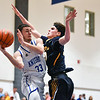 (01/30/18 LUNENBURG MA) Lunenburg senior captain Connor Palma (left) passes the ball around Tigers junior Ross Cotnam in Tuesday nights game at home.  SENTINEL & ENTERPRISE JEFF PORTER