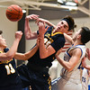 (01/30/18 LUNENBURG MA) Littleton junior Ross Cotnam (center) tries to regain possession off the rebound in Tuesday night's boys varsity basketball game at Lunenburg.  SENTINEL & ENTERPRISE JEFF PORTER
