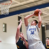 (01/30/18 LUNENBURG MA) Littleton senior captain Mitch Crory (left) puts pressure on Knights junior Jason Reynolds in Tuesday night's boys varsity basketball game at Lunenburg High School.  SENTINEL & ENTERPRISE JEFF PORTER